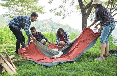 Friends breaking down tent - The Skilled Survivor