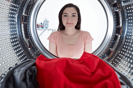 woman-looking-into-a-front-loading-washing-machine